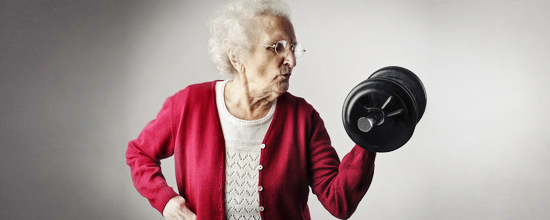 Elderly lady weight lifting
