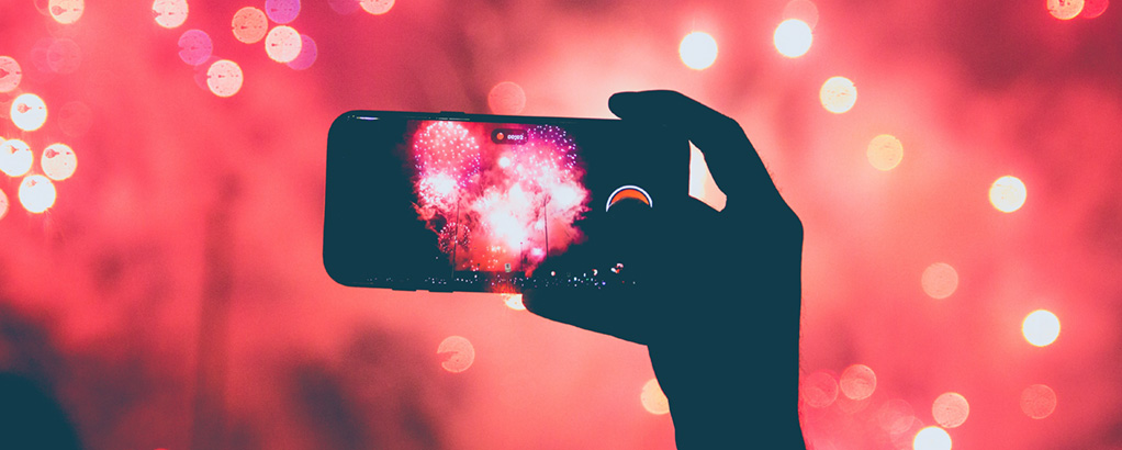 Picture of a phone screen and fireworks